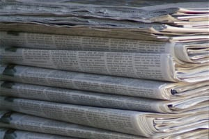 stack of newspapers - Photo by Valerie Everett. Licensed under CC 2.0  https://creativecommons.org/licenses/by/2.0/